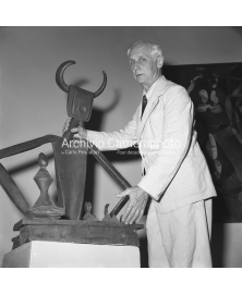 With His Sculpture