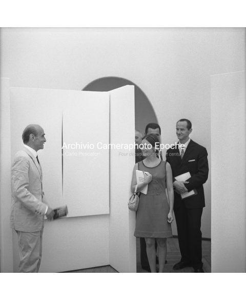 Lucio Fontana - Presenting His Paintings
